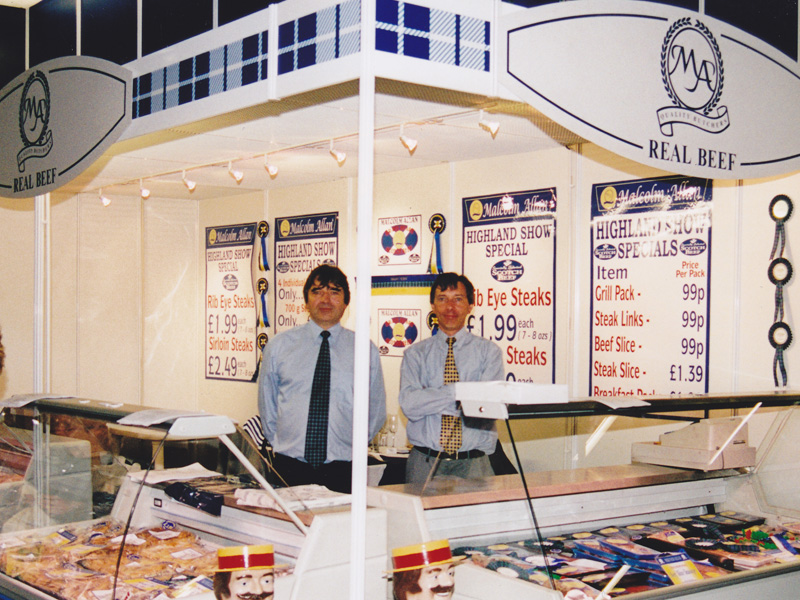 Gordon and James Allan on the Malcom Allan Stand at the Highland Show - 1998